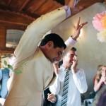 High arm hole on a linen wedding suit.